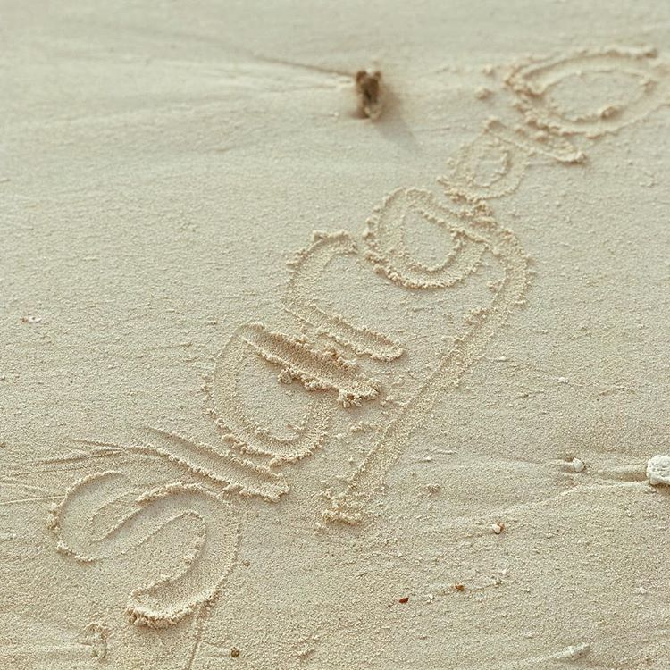 Siargao text written on the sand